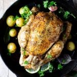 lemon roast chicken in a skillet pan with potatoes