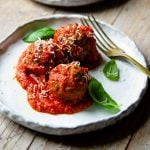 talian meatballs on a rustic plate with tomato sauce and basil