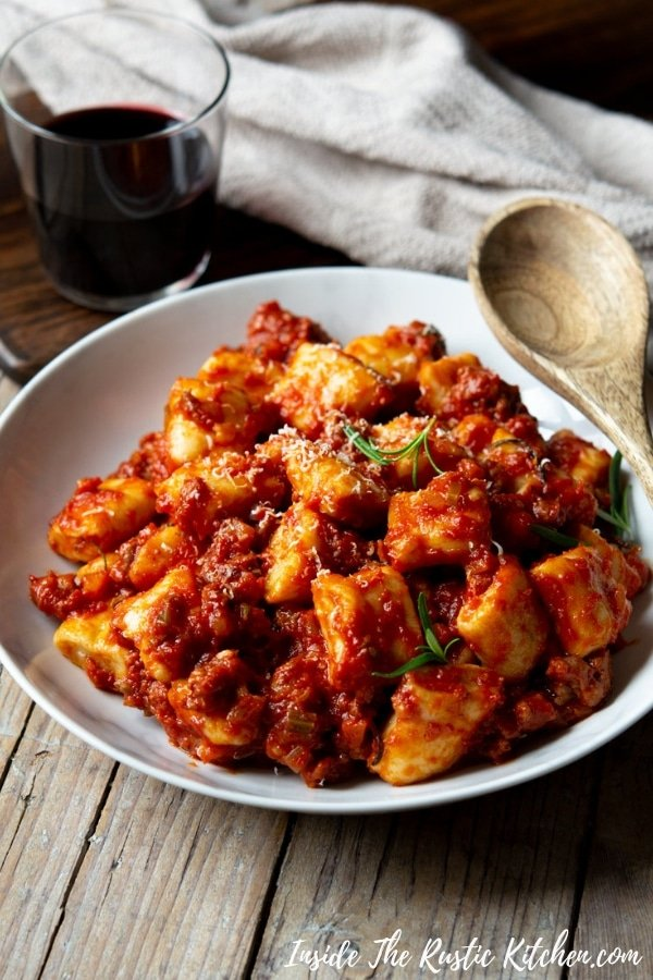 Sausage Ragu with Ricotta Gnocchi. This simple Italian ragu is made with just a few simple ingredients and tastes incredible. Toss it with soft, light ricotta gnocchi and you have the perfect lazy weekend meal. | Authentic Italian Recipes | Traditional Italian Recipes | Easy Ragu | Sausage Pasta Sauce | #Insidetherustickitchen #ragu #sausage #Italian #Italianrecipes