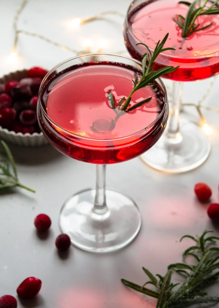 A Christmas cocktail with rosemary and cranberries