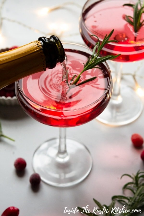 Santa Spritz Christmas Cocktail. A delicious, fun and fizzy festive cocktail made with prosecco, gin and cranberry juice. It couldn't be easier and tastes so delicious. Perfect for parties or sipping with festive nibbles. #Insidetherustickitchen #Christmas #Cocktail #Prosecco