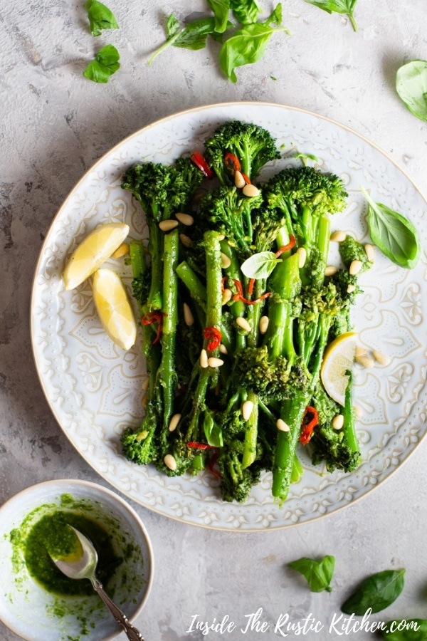 Sauteed Broccolini with Pesto, Pine Nuts and Chilli. This simple side dish is packed with flavour, so good you can eat it just as it is for lunch or a snack. Pair this broccolini with roast meats, fish or salad for a complete meal.   Italian Sides   Healthy Sides   Broccoli Sides   #Insidetherustickitchen #broccolini #sides #pesto