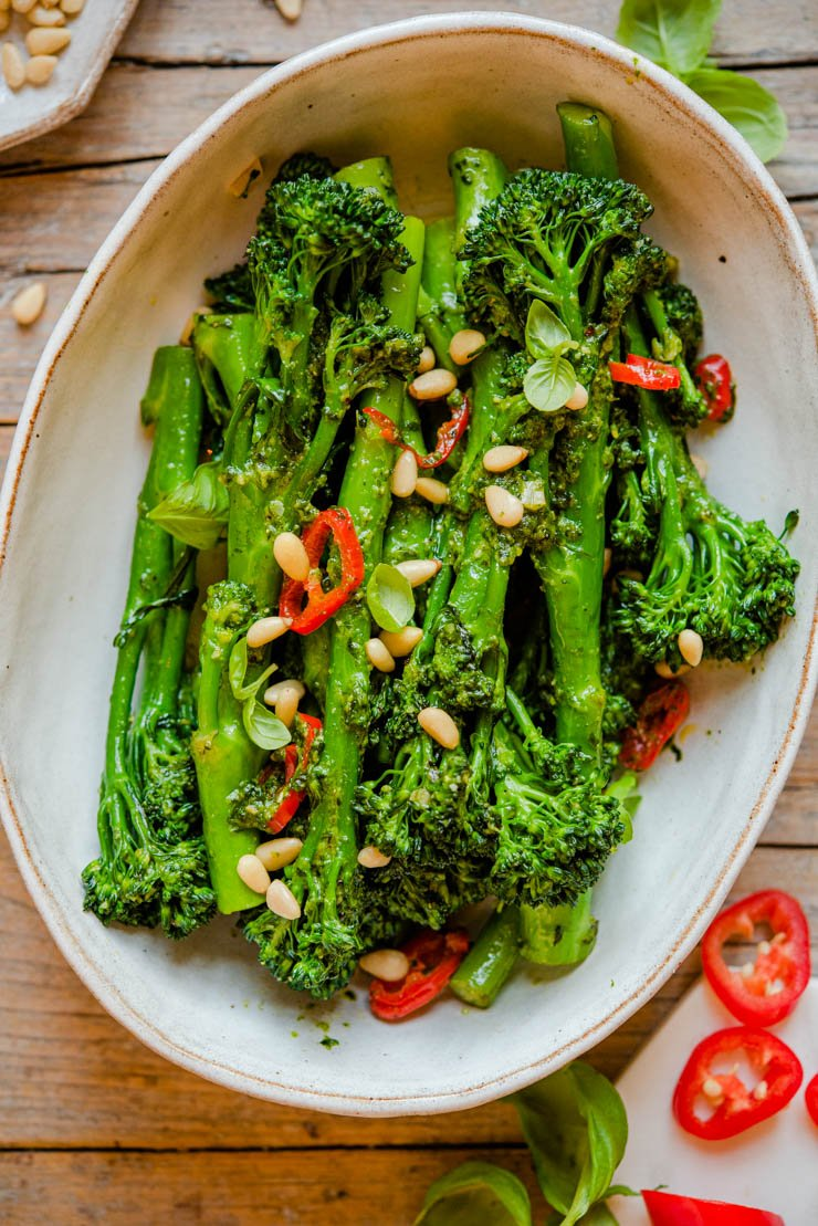 A close up of sauteed broccolini in a bowl