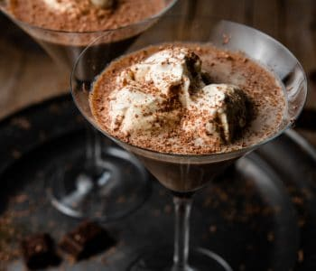 A close up of a chocolate martini on a pewter plate