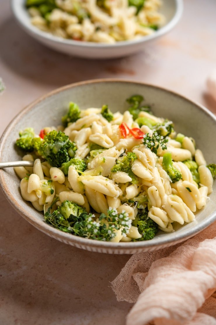 A close up of cavatelli and broccoli pasta in a bowl