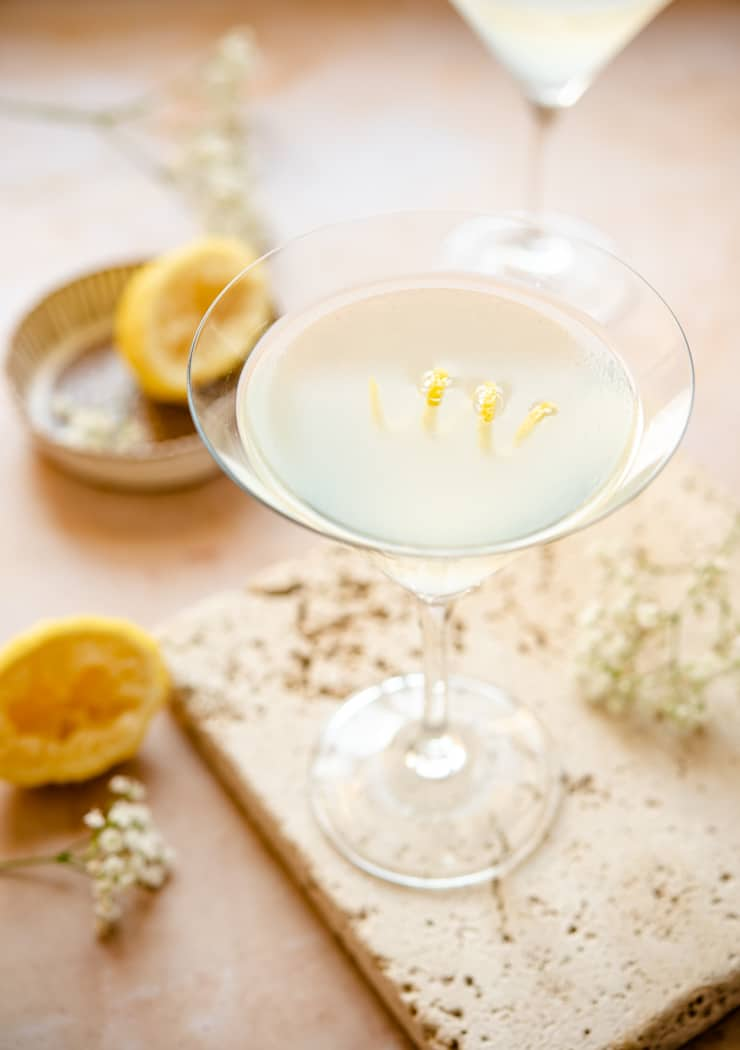 Limonello martini in a martini glass with lemon peel garnish