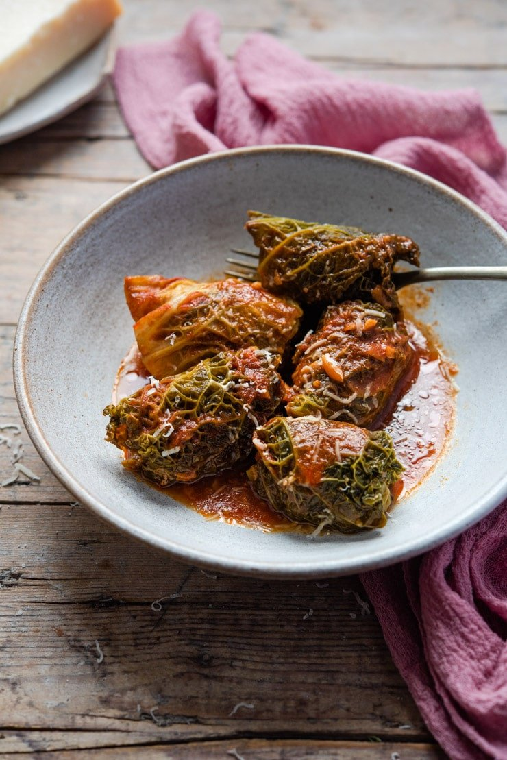 Stuffed cabbage rolls in a bowl with tomato sauce