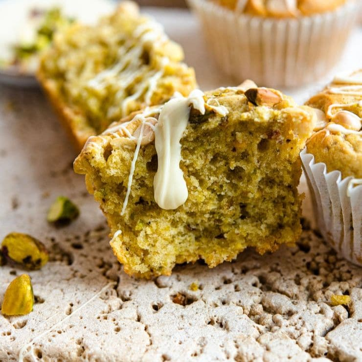 Pistachio Muffins With White Chocolate Chips Inside The Rustic