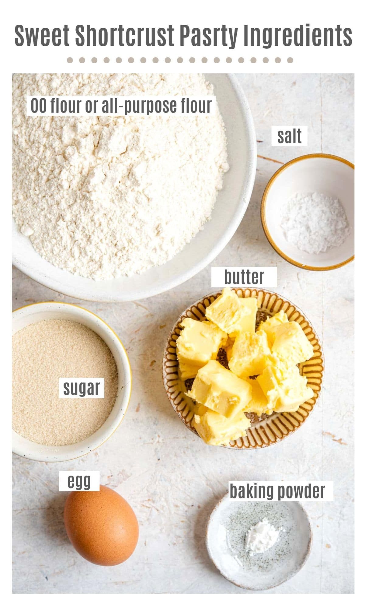 An overhead shot of all the ingredients needed to make sweet shortcrust pastry