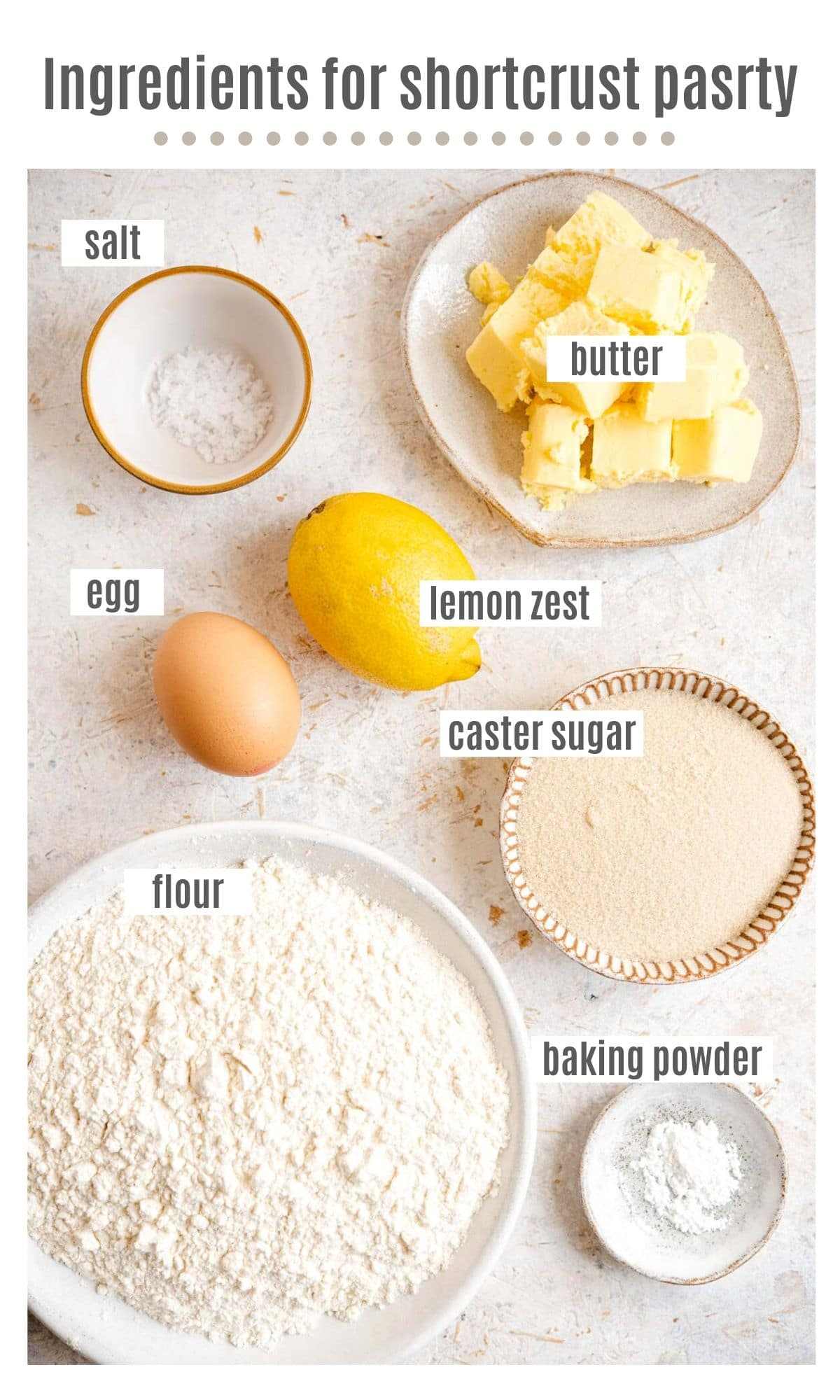 An overhead shot of ingredients you need to make shortcrust pastry with lemon zest
