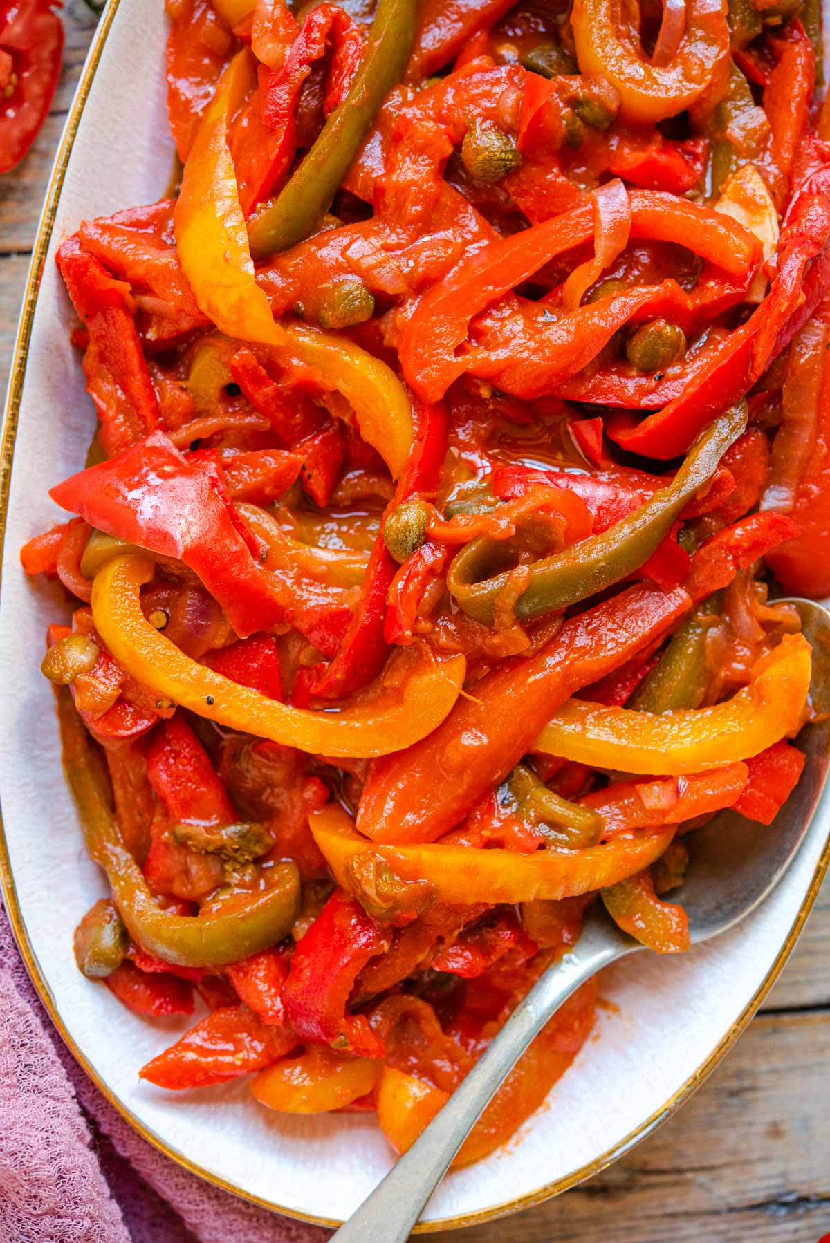 A close up of peppers in tomato sauce on a serving plate