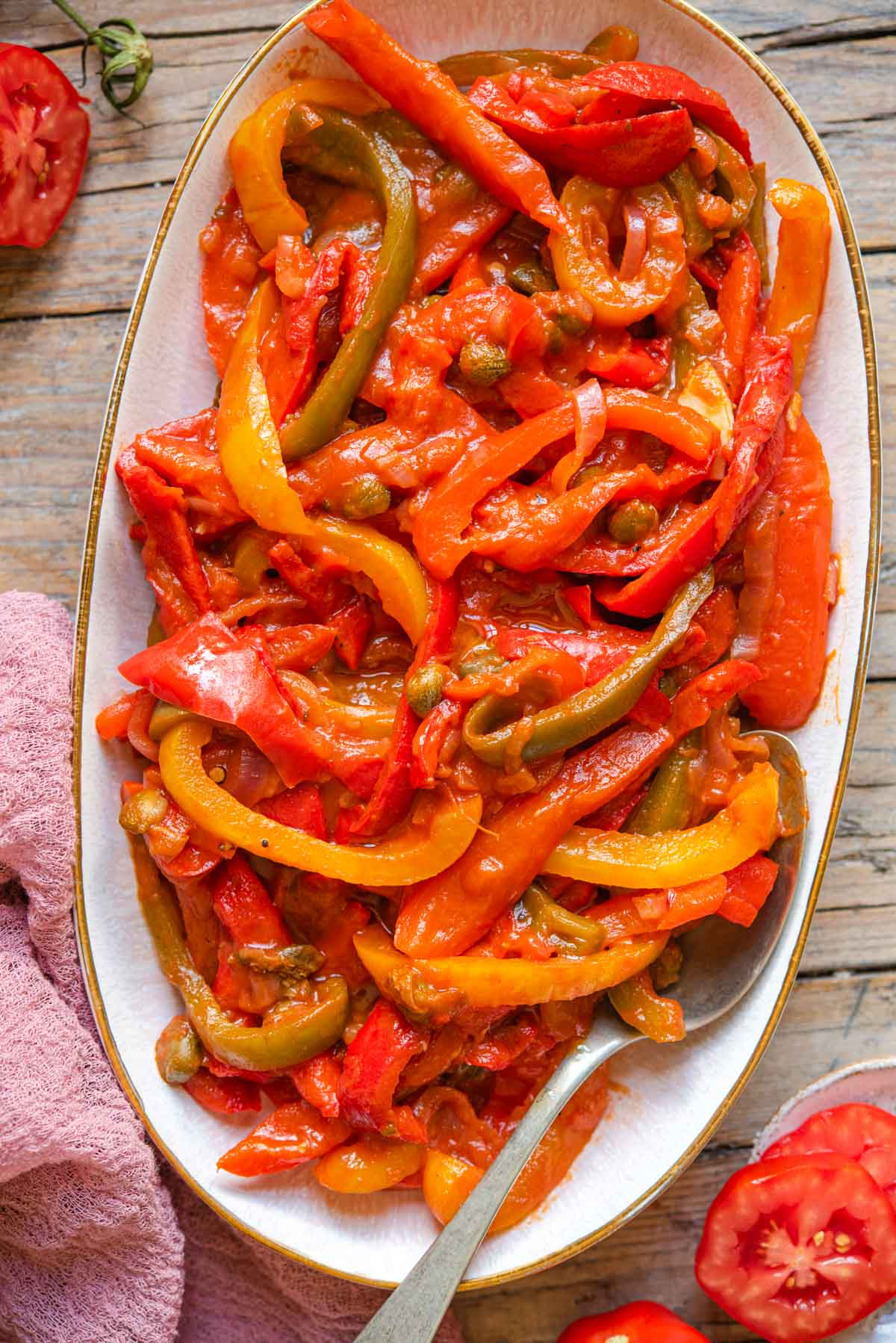 Peppers in tomato sauce on a serving plate