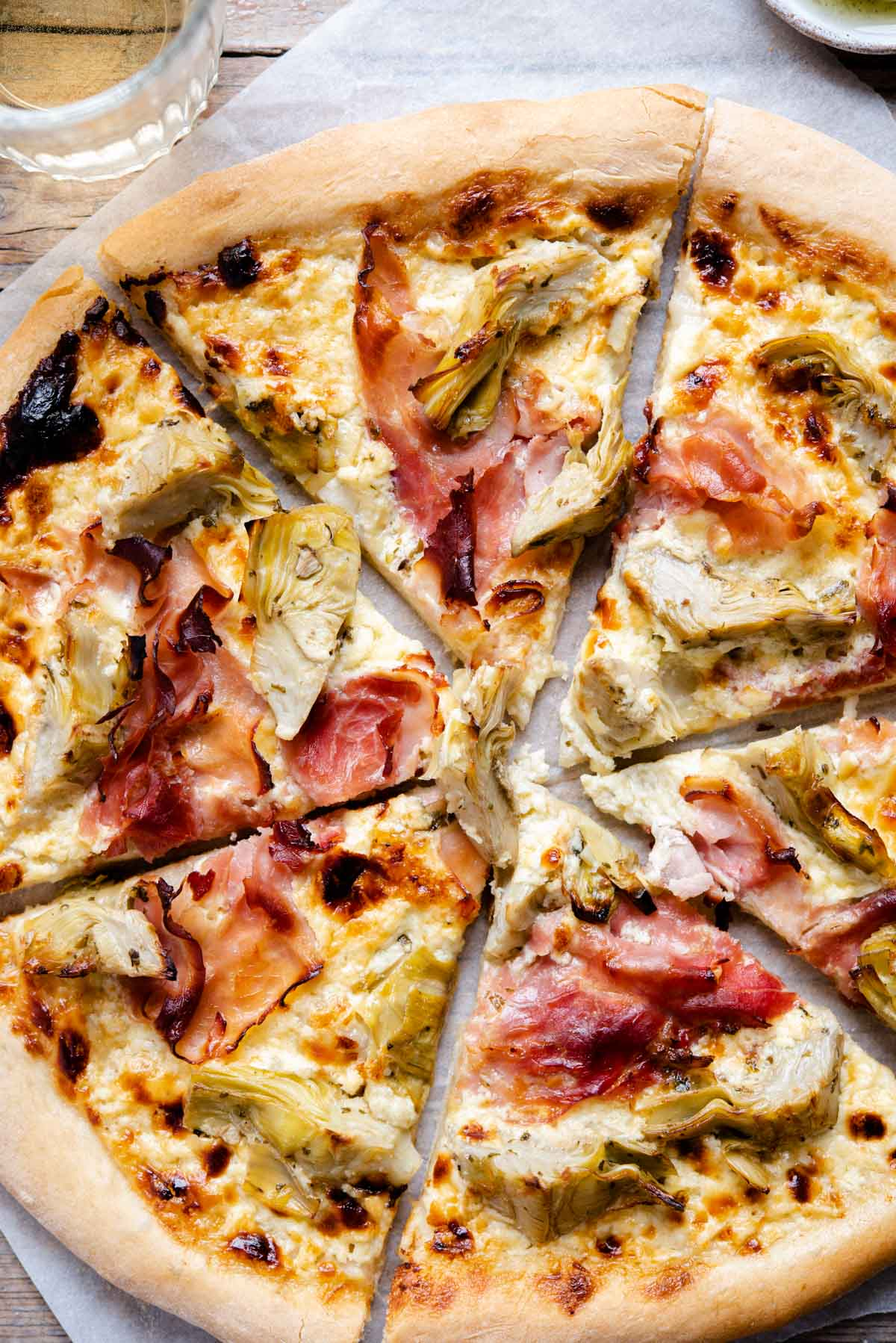 A close up of artichoke pizza with ham