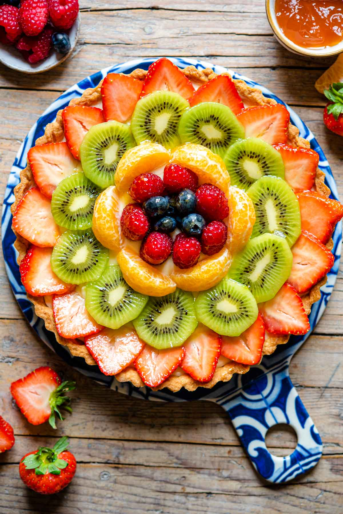 An overhead shot of an Italian fruit tart filled with pastry cream