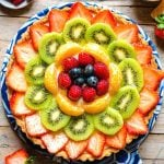 A square image of an Italian fruit tart