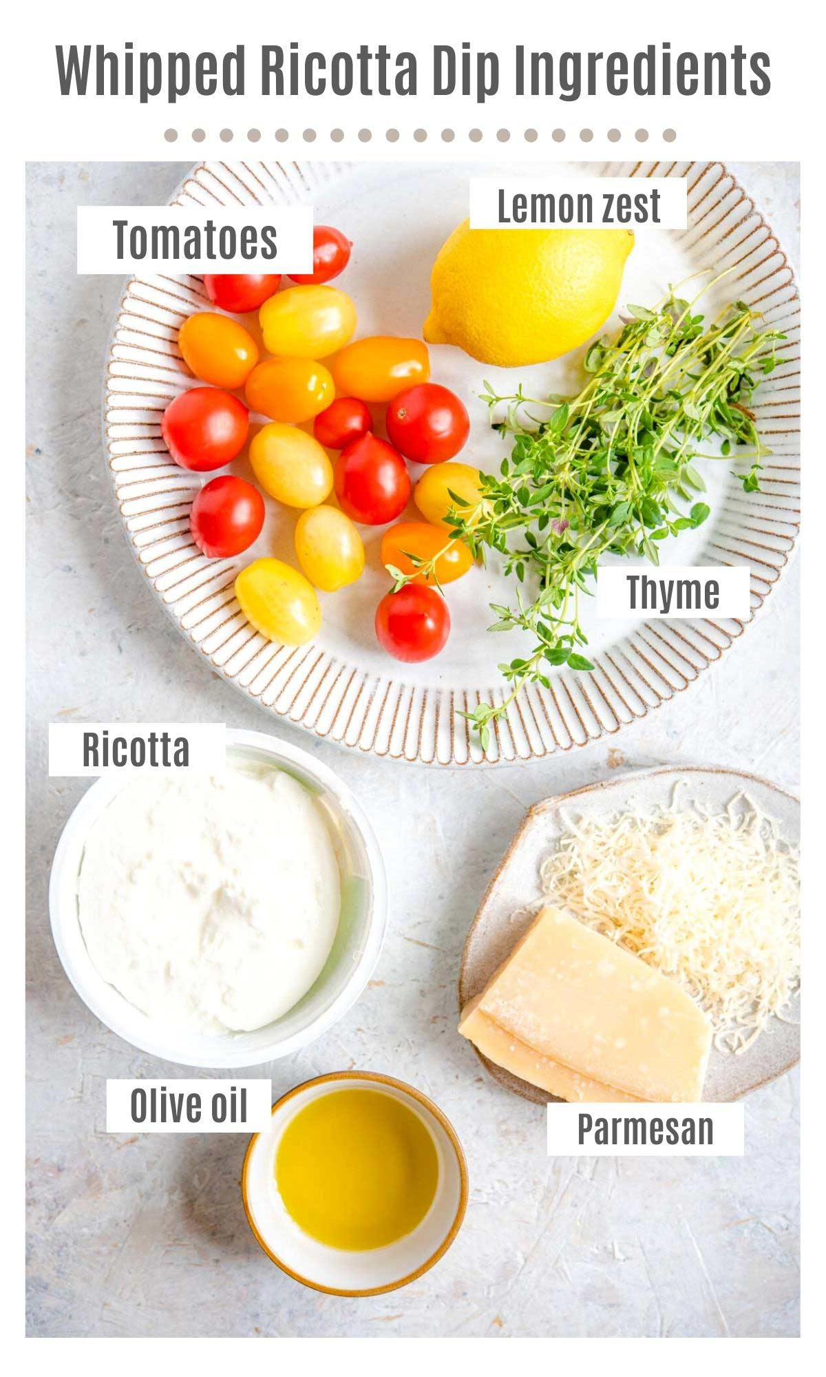 An overhead shot of all the ingredients you need to make whipped ricotta dip with tomatoes