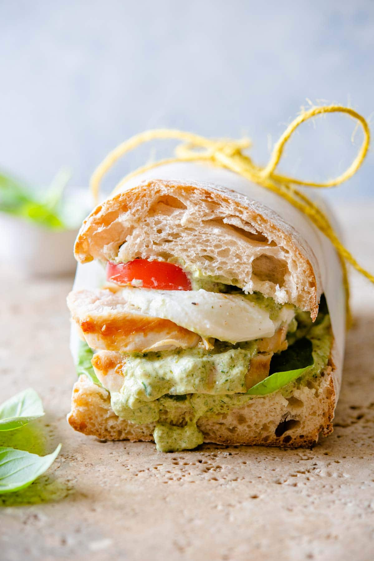 A close up of a chicken ciabatta sandwich with pesto