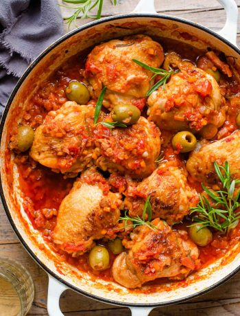 An overhead shot of chicken cacciatore in a skillet