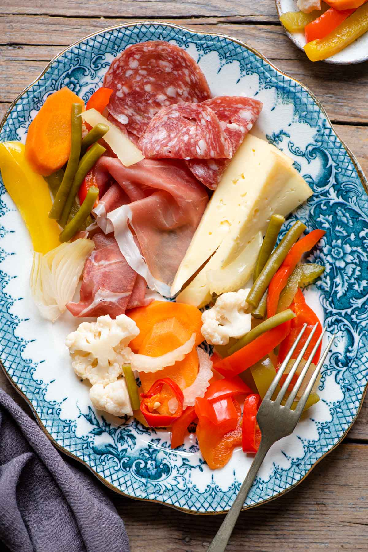 Italian pickled vegetables on a platter with cured meats and cheese