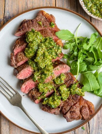 Salsa verde drizzled on top of steak