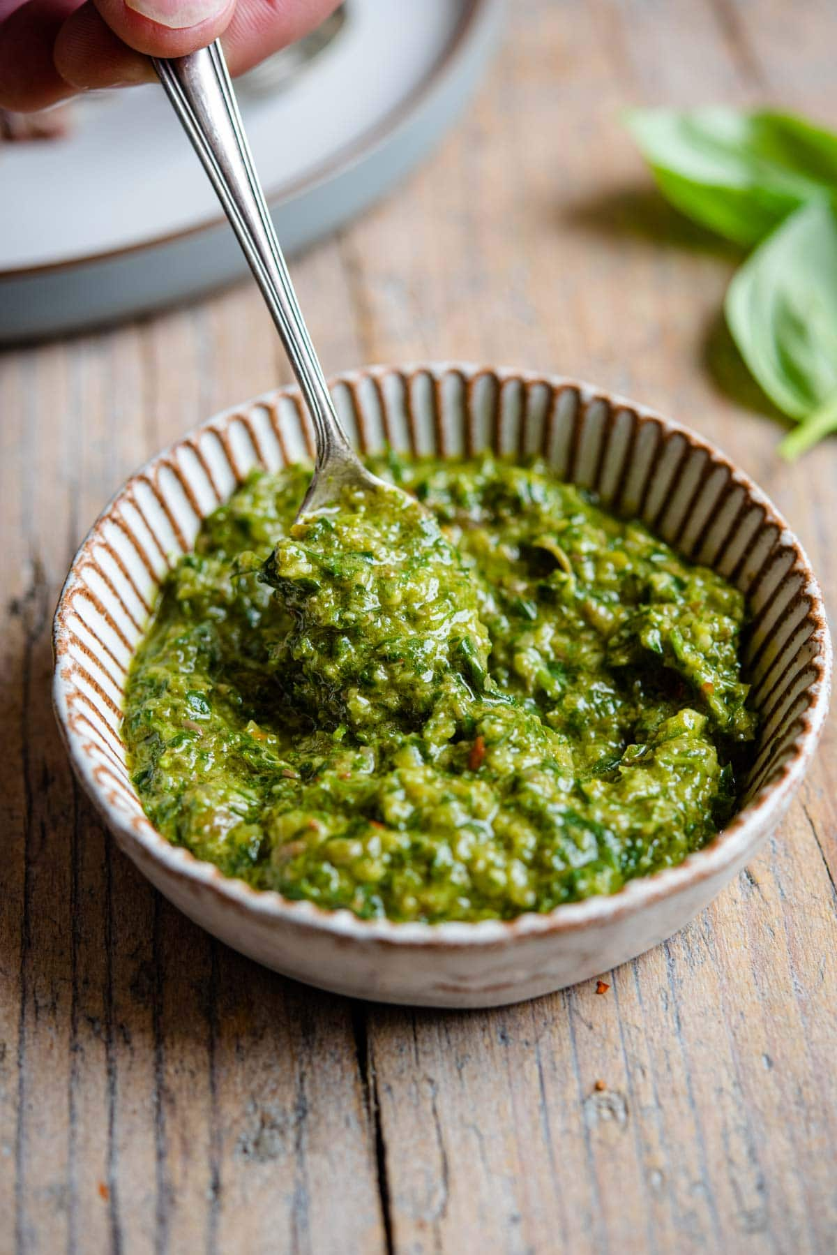 A close up of salsa verde in a ramekin