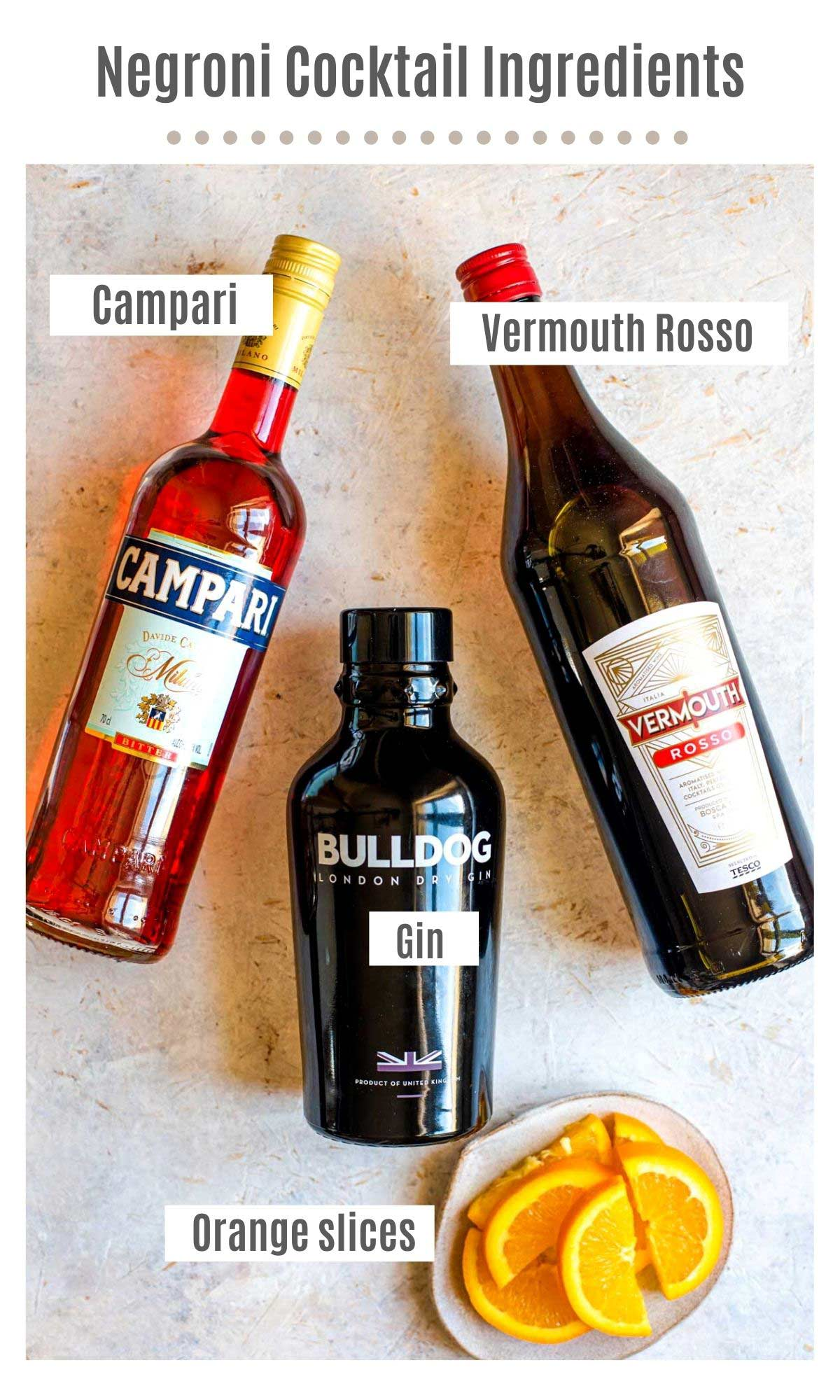 An overhead shot of all the ingredients you need to make a negroni cocktail