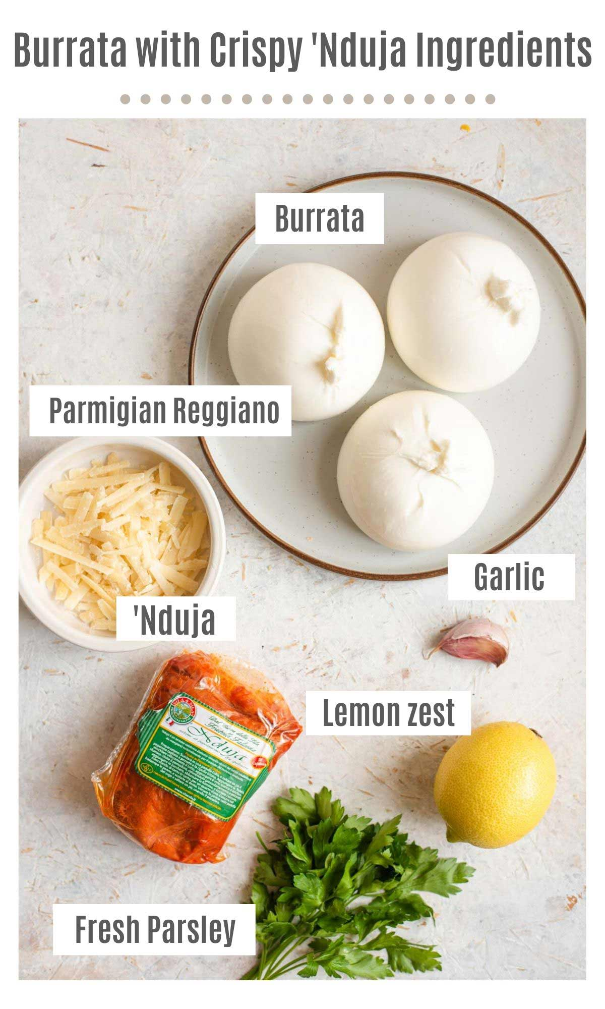 An overhead shot of all the ingredients you need to make Burrata with 'Nduja and gremolata