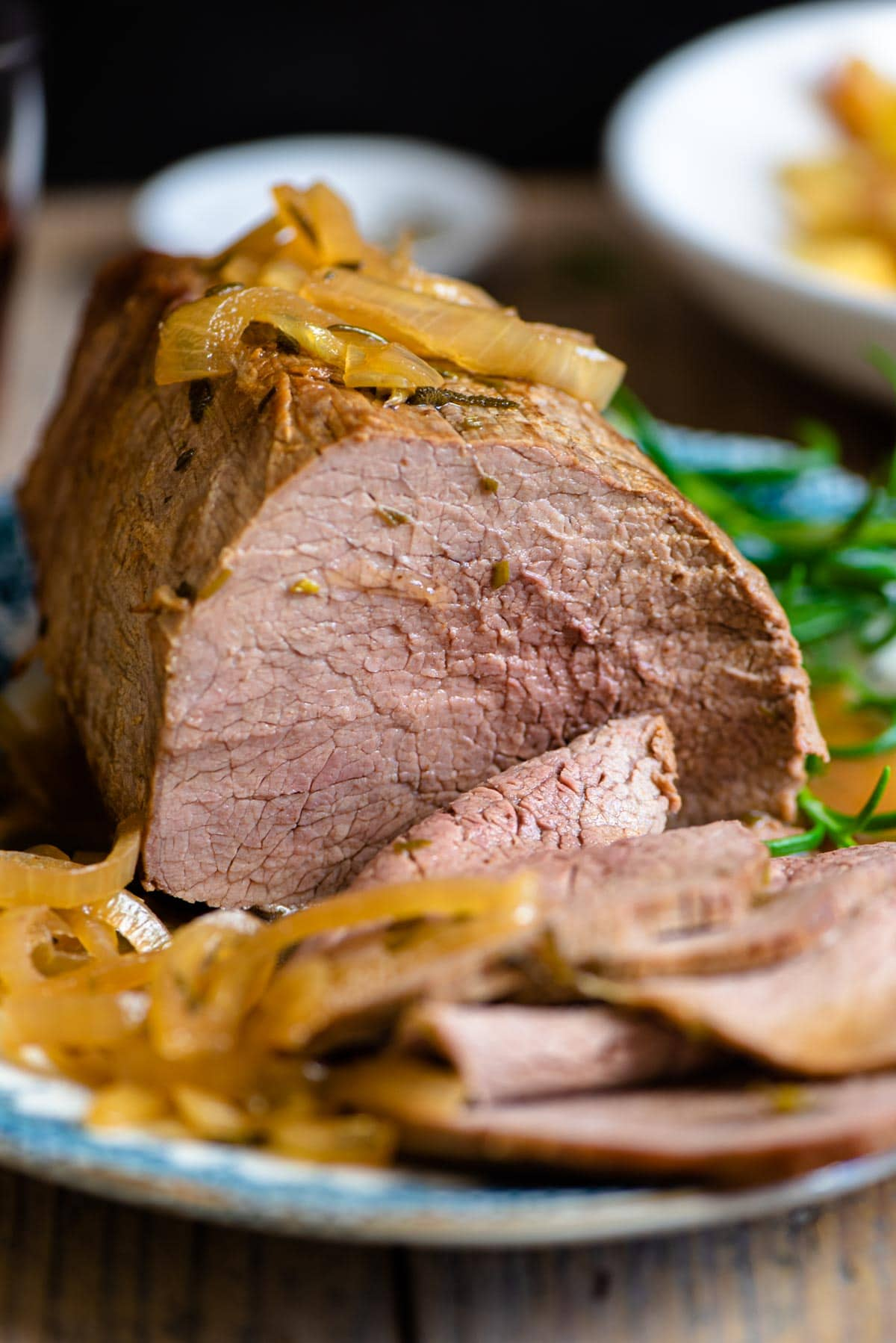 A close up of Itlaian roast beef with onions