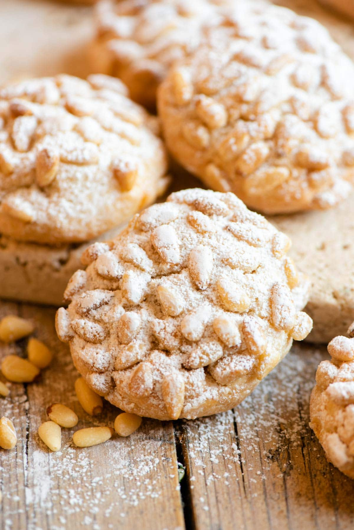 A close up of an Italian cookie with pine nuts