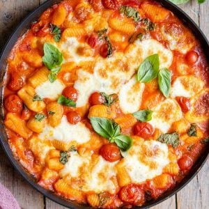 A close up of baked gnocchi in a skillet