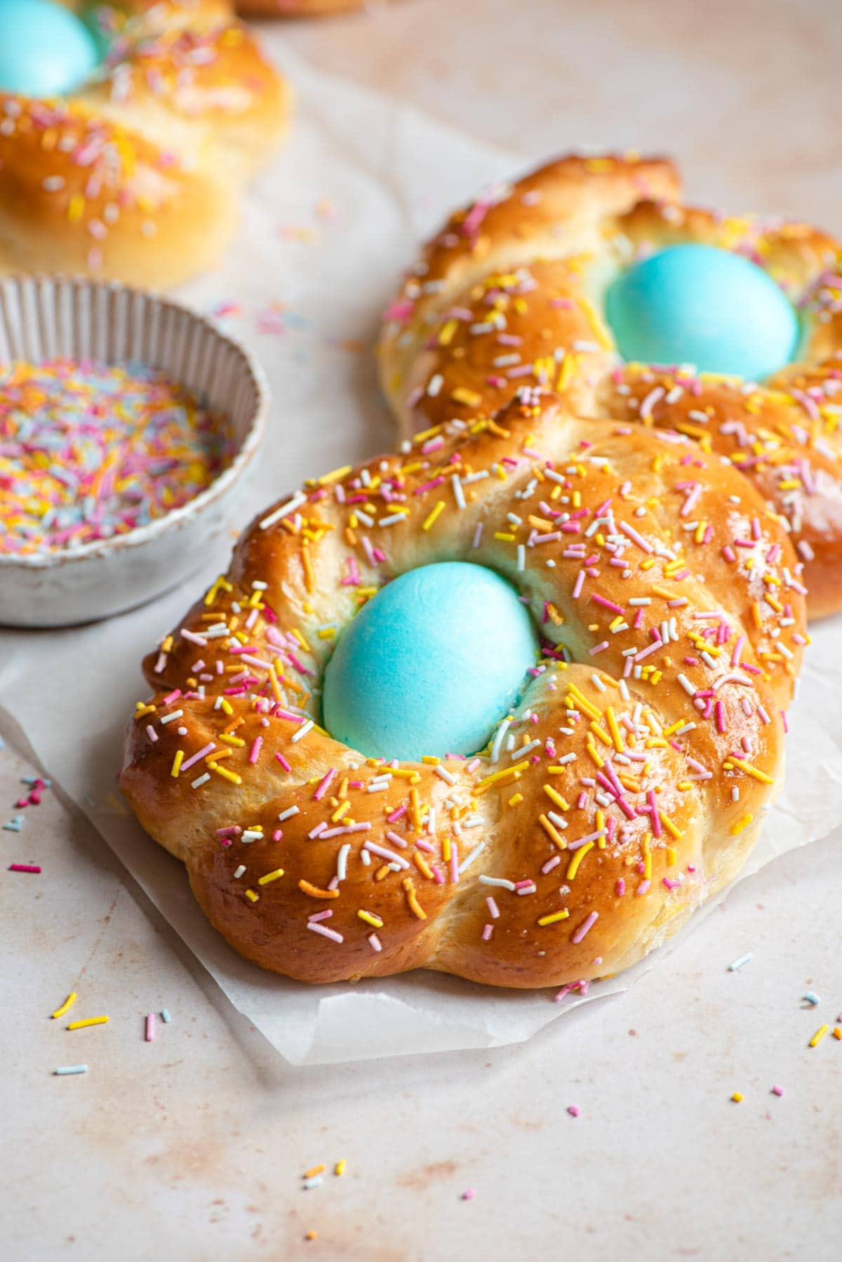 Italian Easter bread with a blue egg in the middle covered with sprinkles