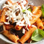 A close up of pasta alla norma in a bowl