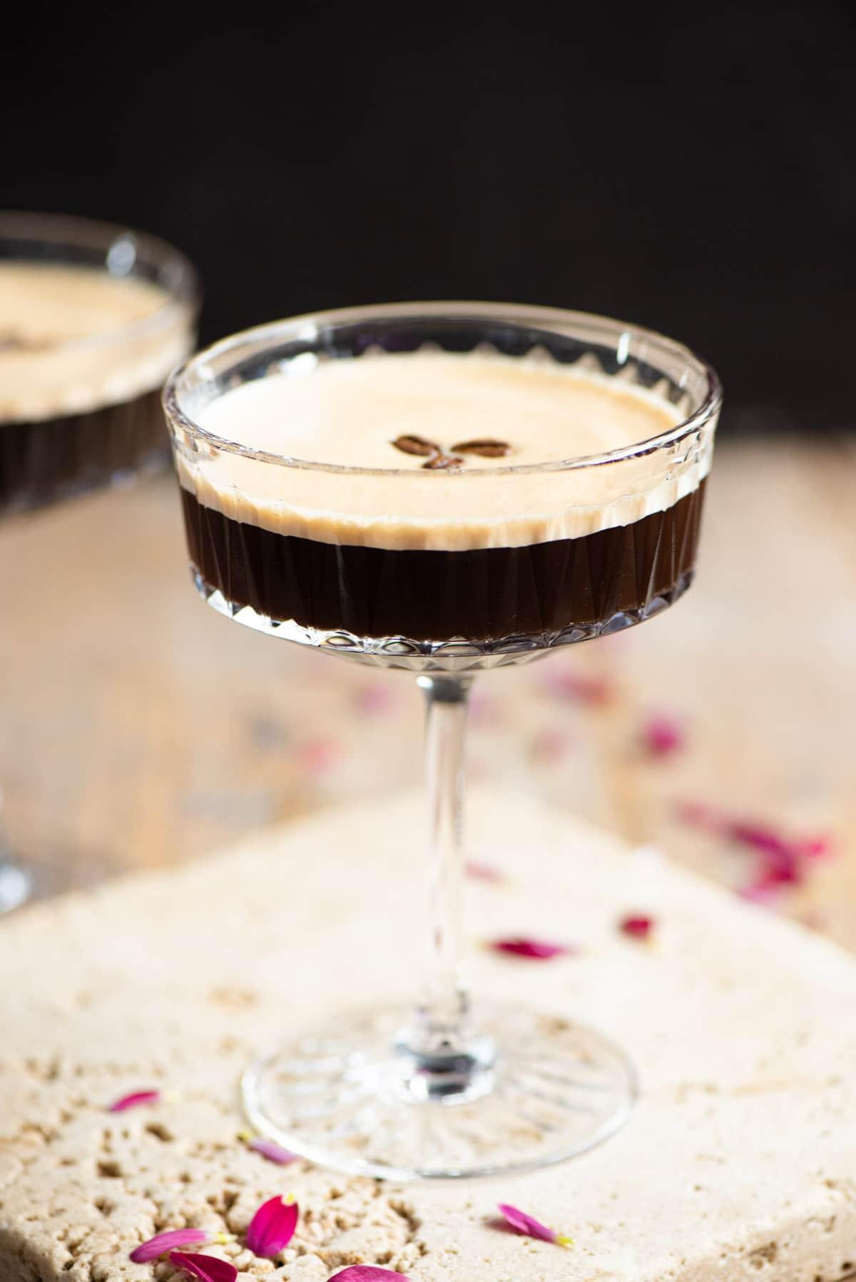 An espresso martini in a cocktail glass