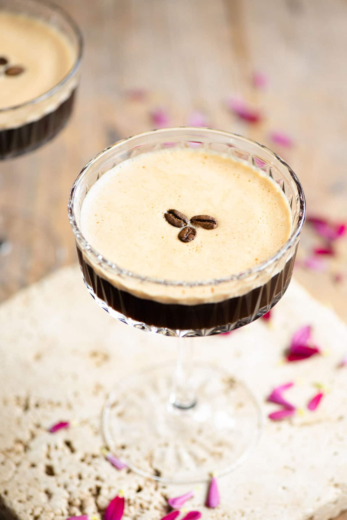 An espresso martini with 3 coffee beans on top