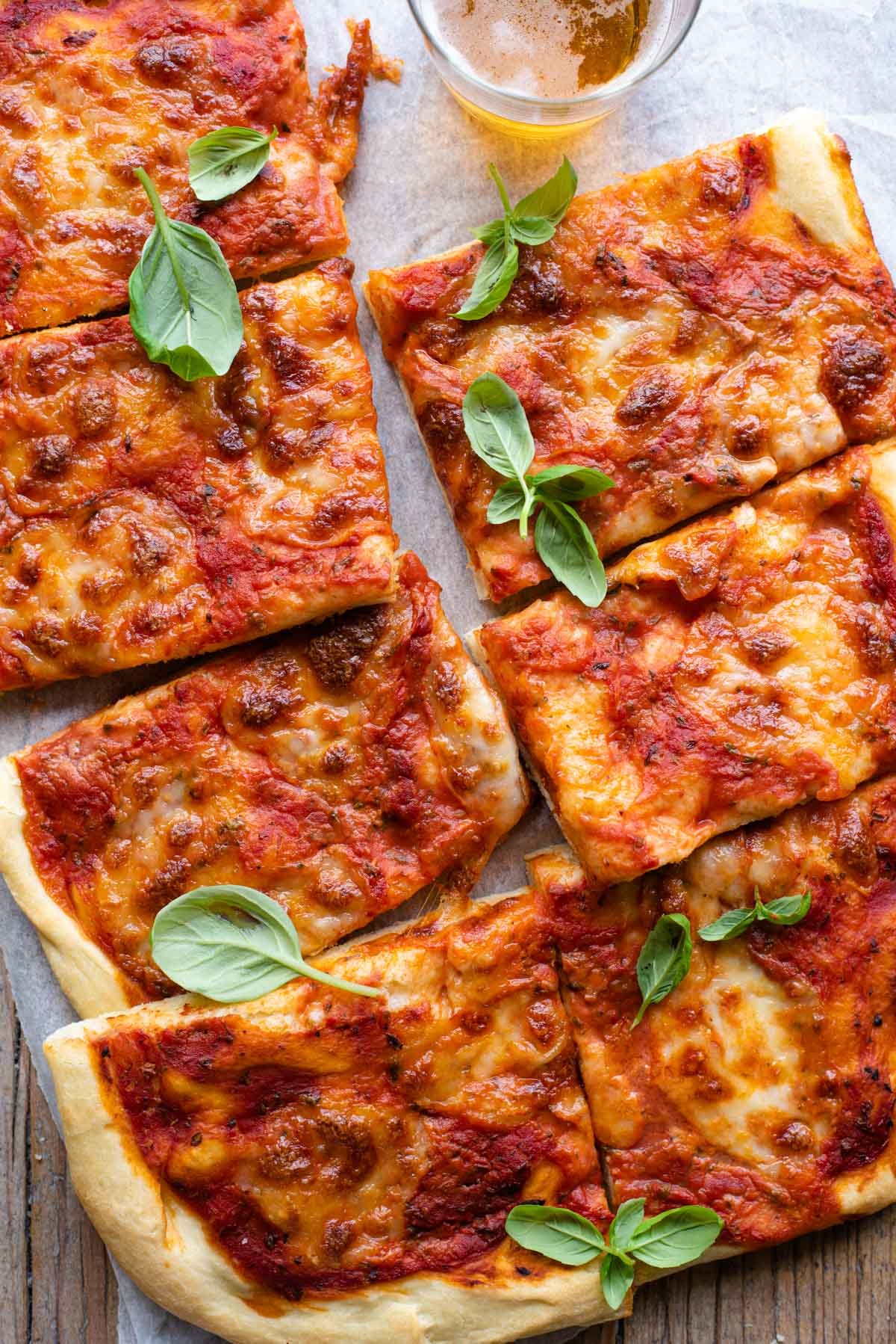 An overgead shot of a focaccia pizza cut into slices