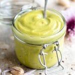 A close up of pistachio cream in a jar